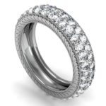 Diamond eternity wedding band with mil grain edging and engraving on the sides