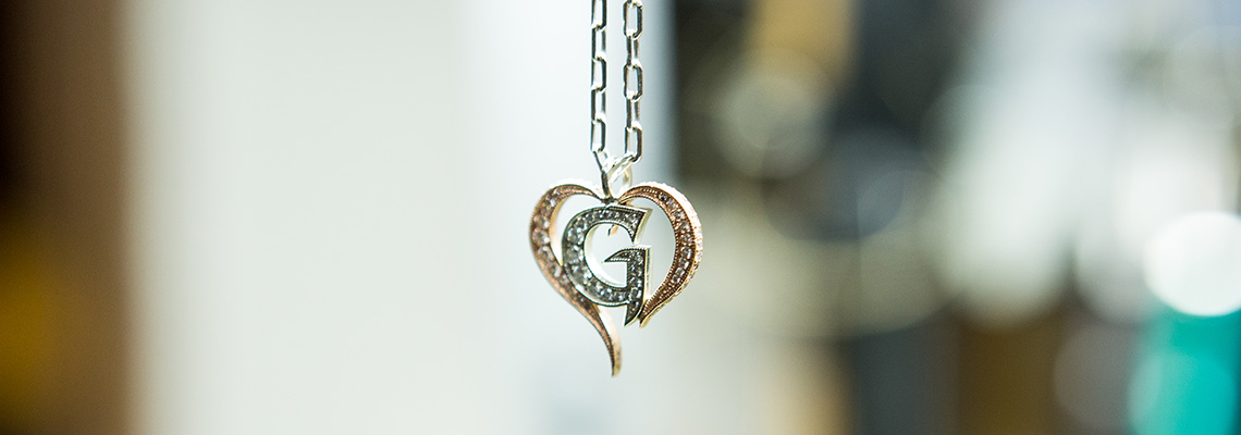 G Pendant rose and white gold